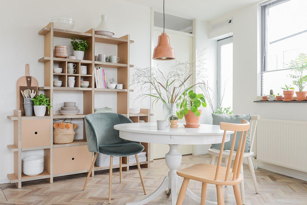 Salle à manger relaxante en bois et blanc qui est savoureuse en espace