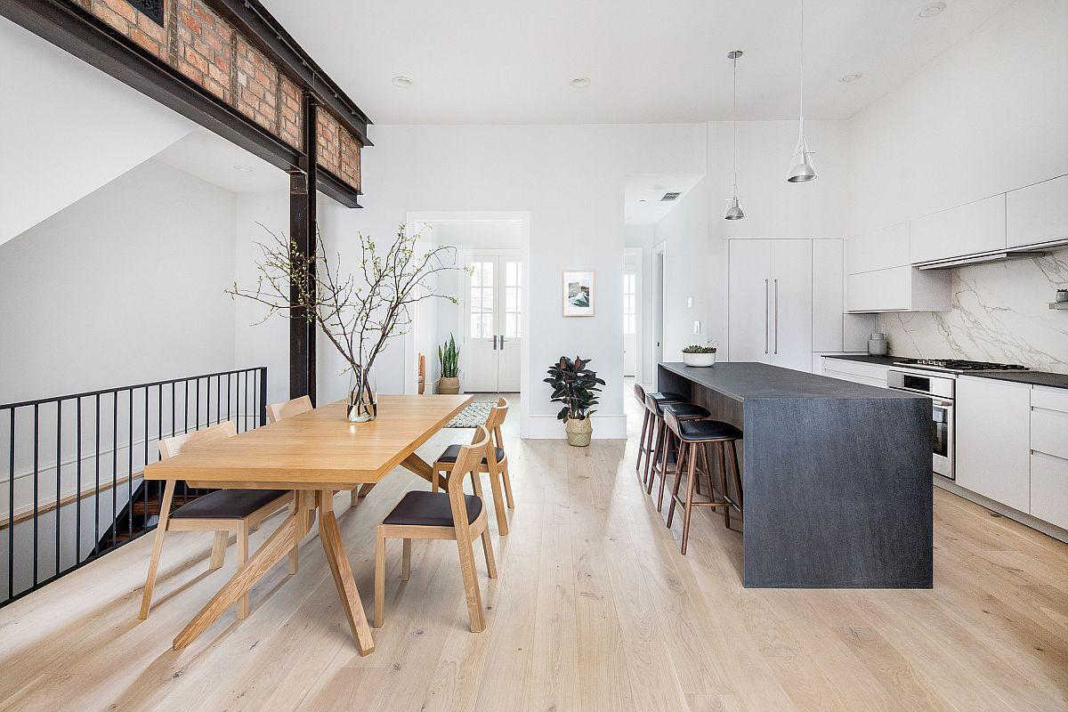 La salle à manger et la cuisine de style scandinave moderne se sentent comme une extension l'une de l'autre