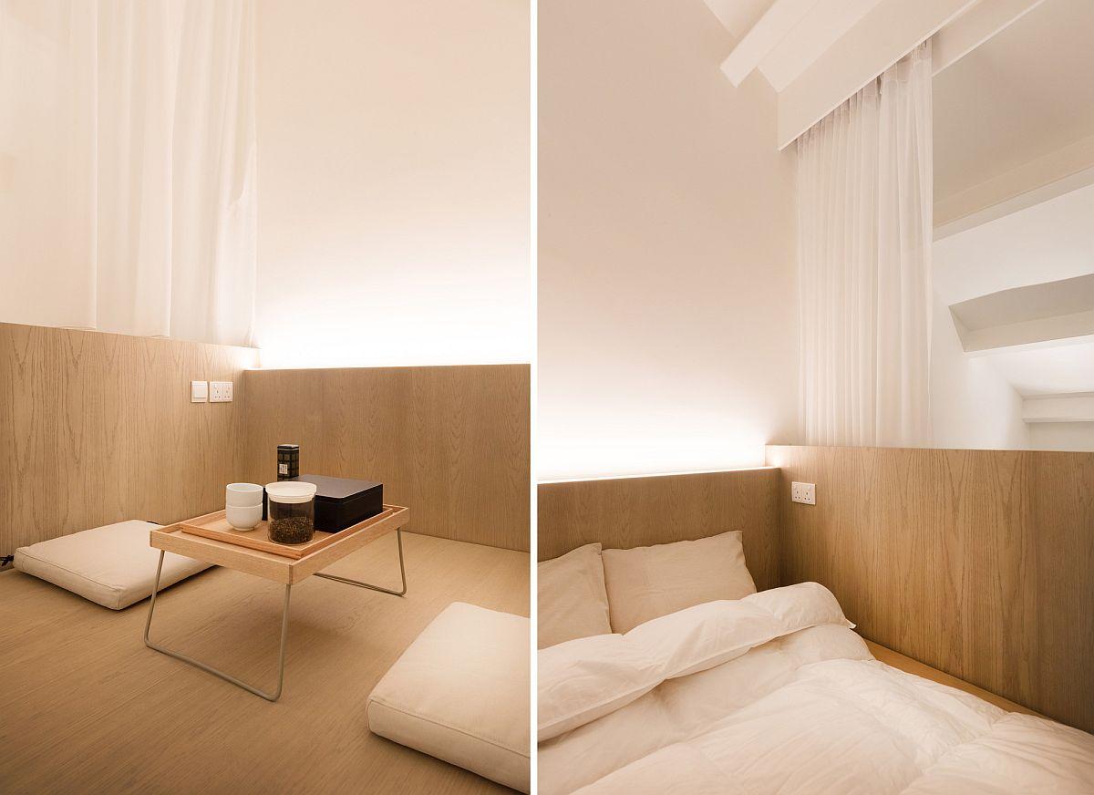 Regardez de plus près la chambre au niveau du grenier de l'appartement en bois et blanc