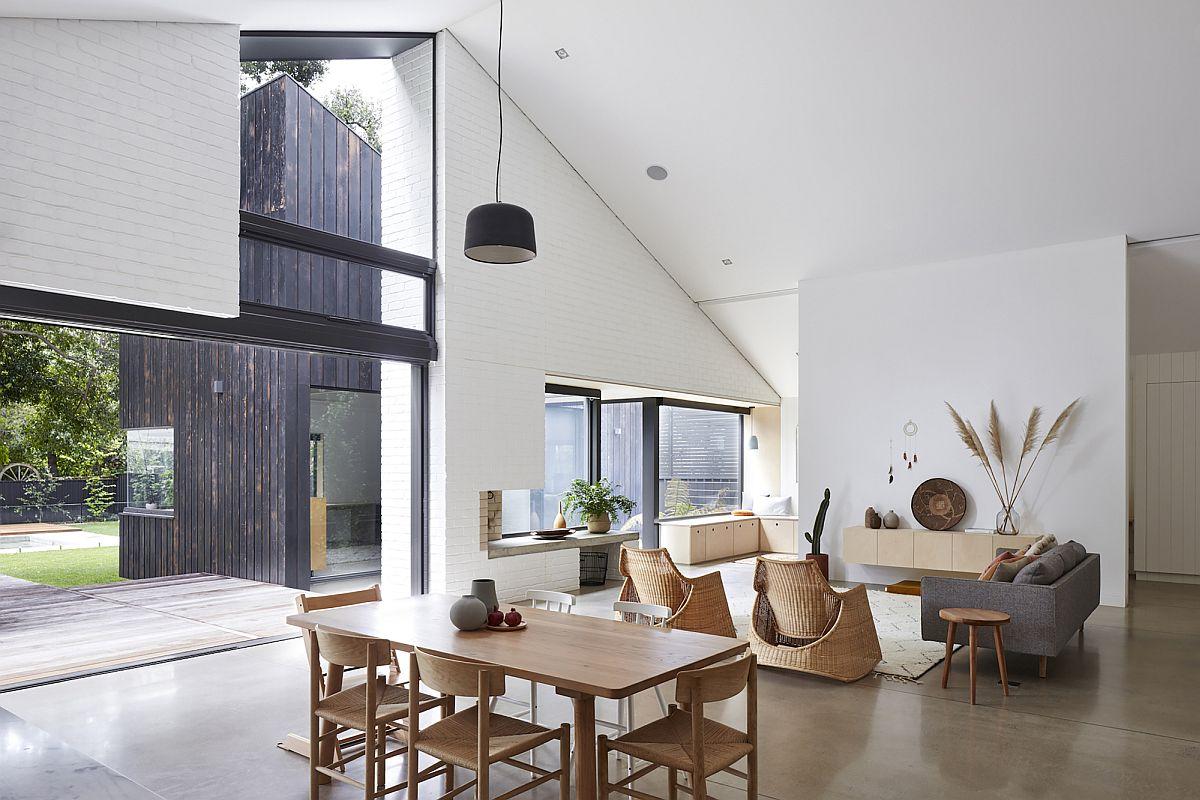 Les tons blancs, neutres et bois clairs façonnent l'intérieur élégant et élégant