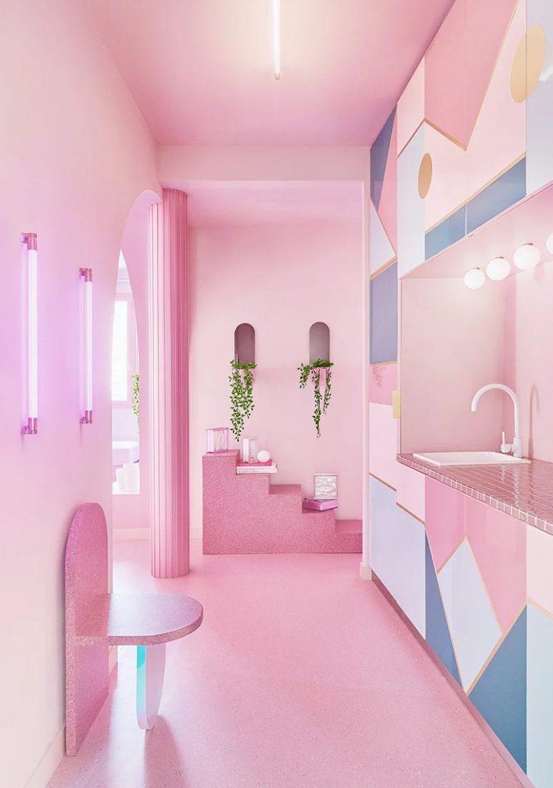 La cuisine est faite de blanc, bleu et rose, avec des carreaux roses, des imprimés géométriques accrocheurs et des meubles en pierre qui bascule