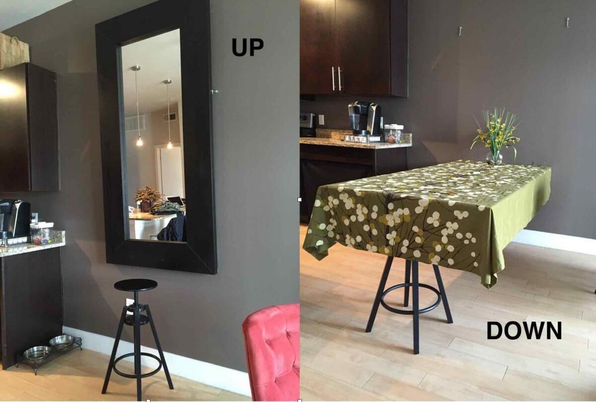 Le miroir fixé au mur se transforme en table de cuisine
