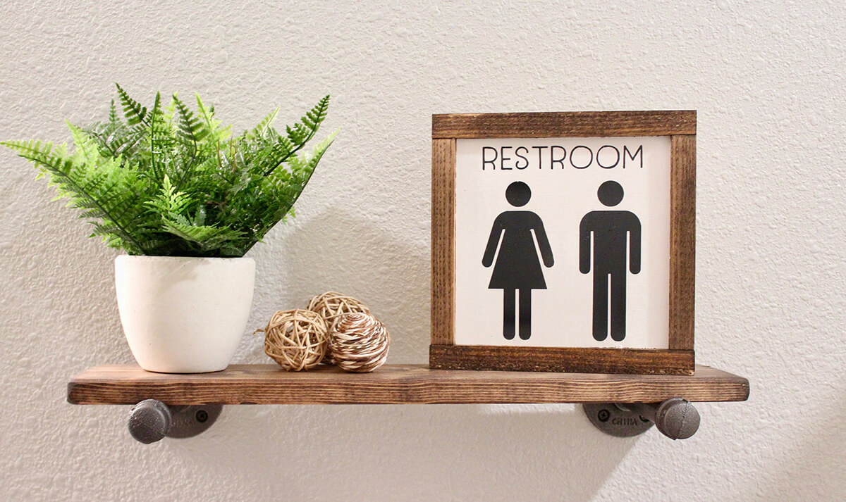 Panneau de toilettes de ferme en bois rustique