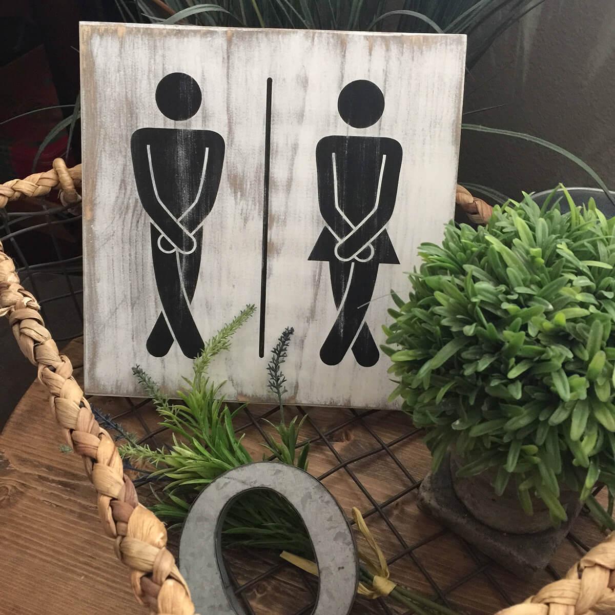 Signe de toilettes drôle lui et elle