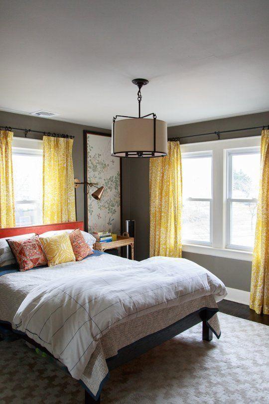 un design de chambre élégant dans des couleurs grises et jaunes