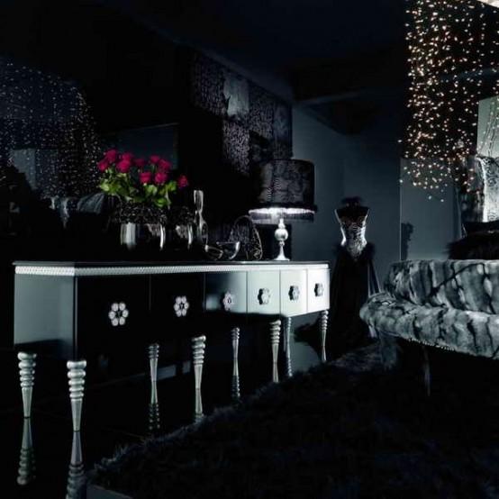 un salon gothique moderne tout sombre avec des murs noirs, des meubles raffinés, un auvent clair et des œuvres d'art audacieuses
