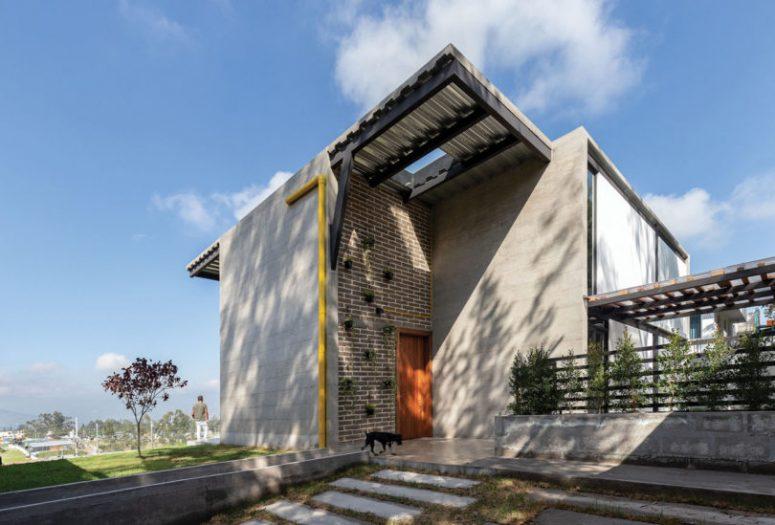 La maison présente une esthétique industrielle contemporaine avec des touches lumineuses ici et là