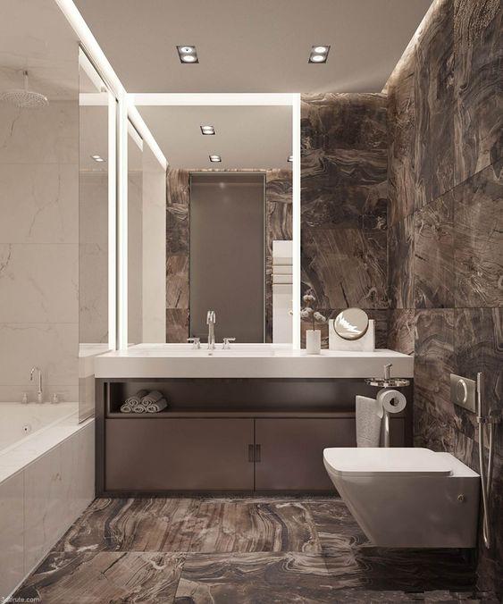 une salle de bain minimaliste avec des carreaux de marbre brun, des appareils électroménagers blancs et des surfaces en pierre est super chic
