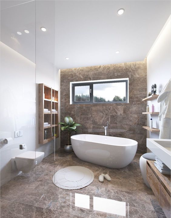 une salle de bains raffinée avec des murs blancs et un mur et un sol en marbre brun, des meubles en bois modernes et des appareils blancs