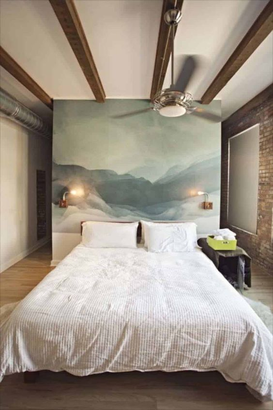 une œuvre d'art abstraite au lieu d'une tête de lit habituelle est une idée cool et chic qui apportera une touche artistique à l'espace