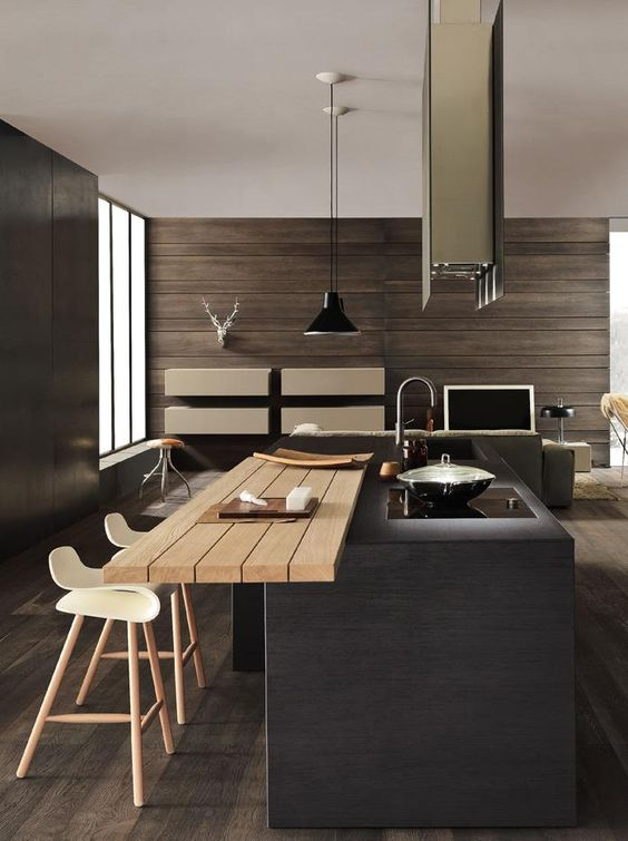 une cuisine minimaliste sombre avec un îlot de cuisine remarquable et un comptoir supplémentaire pour manger ici