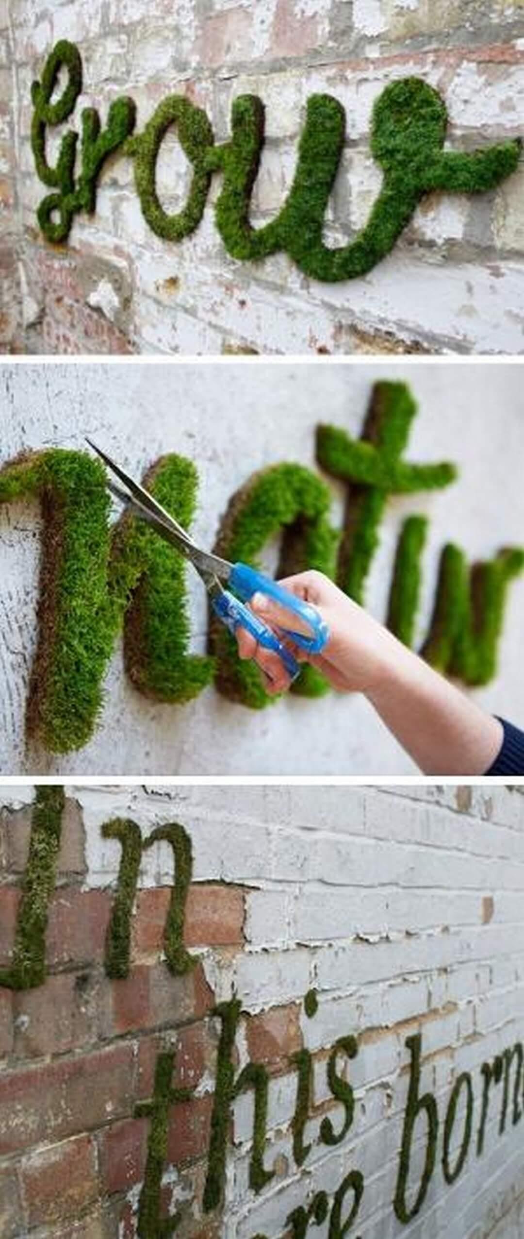 Idée unique de signe de jardin avec de la mousse