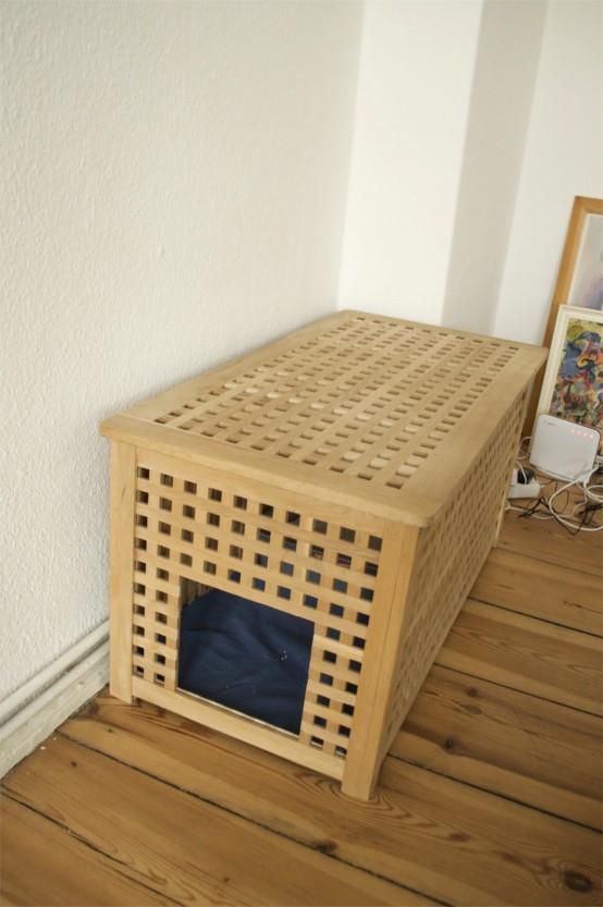 une longue table IKEA Hol avec un lit pour animal domestique à l'intérieur - laissez votre animal dormir à l'intérieur pour se sentir en sécurité et caché