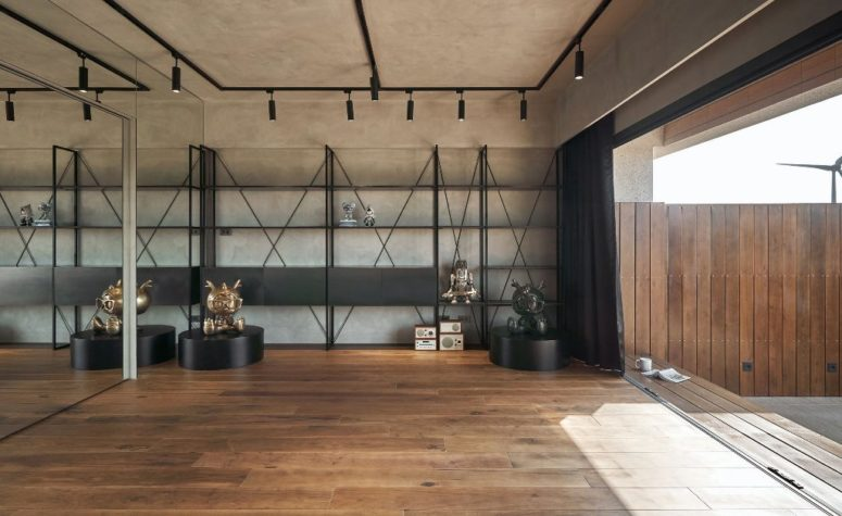 Cet espace est conçu avec des meubles en béton et en métal, il y a une entrée sur la terrasse