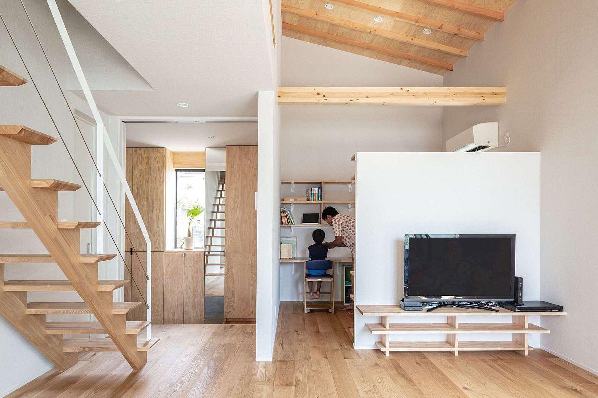 zone-de-travail-dissimulée-de-la-maison-moderne-derrière-la-zone-de-vie-39413